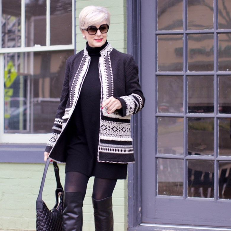 beth from style at a certain age wears a monochromatic outfit cashmere sweater dress from everlane, anthropologie embroidered jacket, black over the knee boots