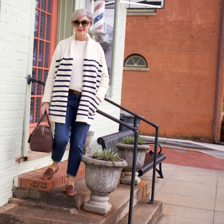 beth from Style at a Certain Age wears a J.Crew cozy striped cardigan, Everlane cashmere crewneck, Talbots girlfriend jeans, J.Crew Ryan loafers