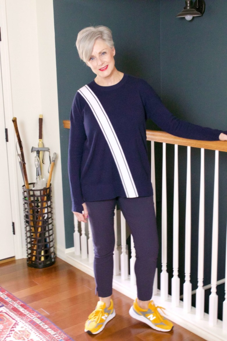 beth from Style at a Certain Age wears travel style Athleta wander slim pants and streetwise sweater