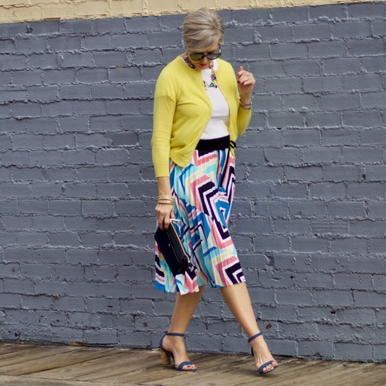 beth from Style at a Certain Age wears a midi skirt from J.C. Penney, white tee, and yellow cardigan