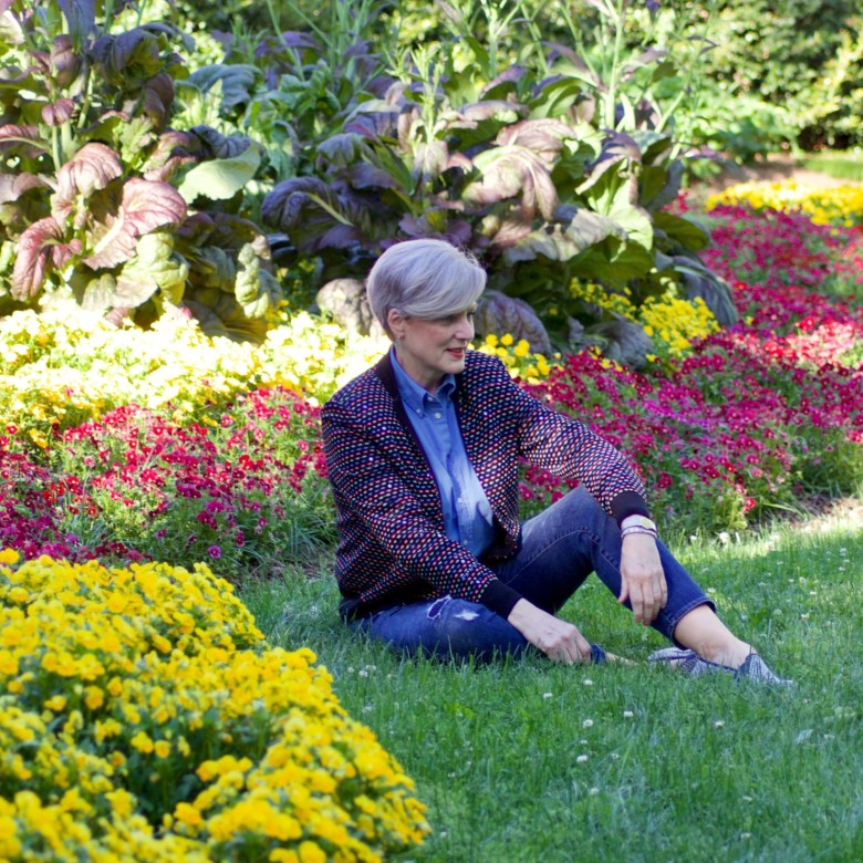 beth from Style at a Certain Age wears high low St. John sweater, J.Crew blue jeans, Ralph Lauren button down, Sam Edelman espadrilles