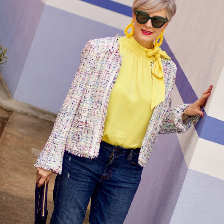 beth from Style at a Certain Age wears a tweed jacket from JC Penney, yellow tie blouse, distressed denim and sandals