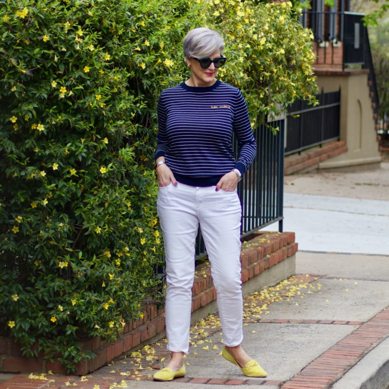 beth from Style at a Certain Age wears a striped sweater and white denim