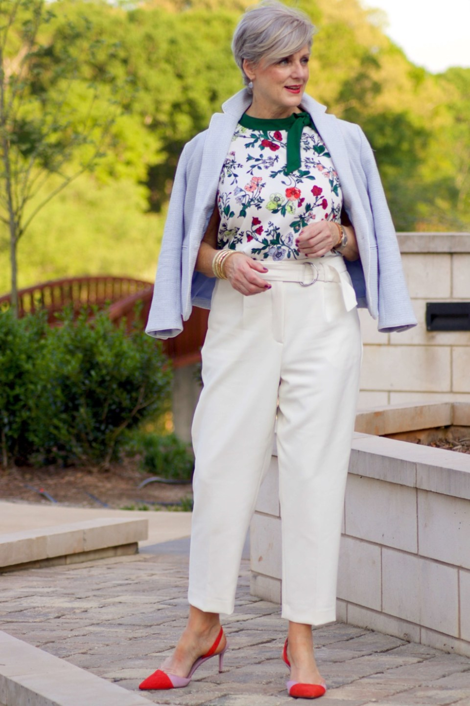 beth from Style at a Certain Age wears Ann Taylor floral sleeveless tie neck blouse, pleated pants, textured blazer, and suede slingbacks