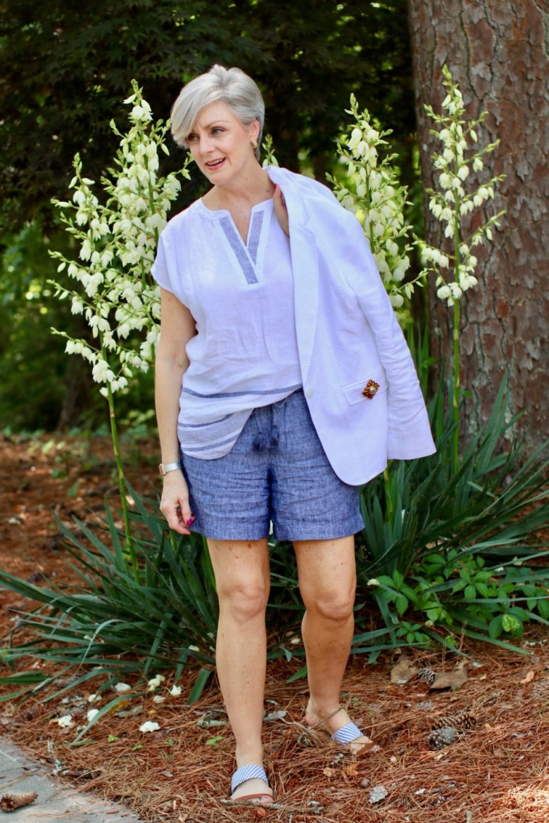 beth from Style at a Certain Age wears a classic summer blazer, drawstring shorts, seersucker sandals, and striped linen top