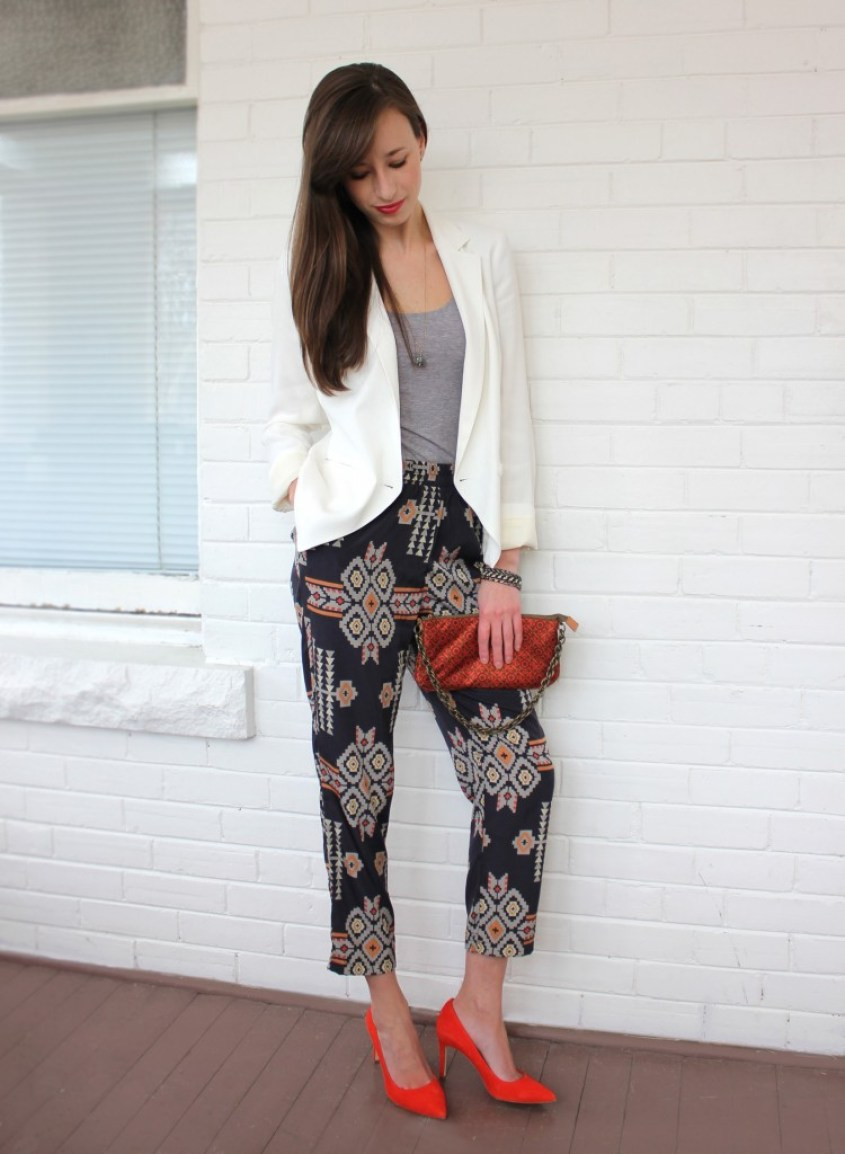 girl in tribal pants, red shoes and a blazer.