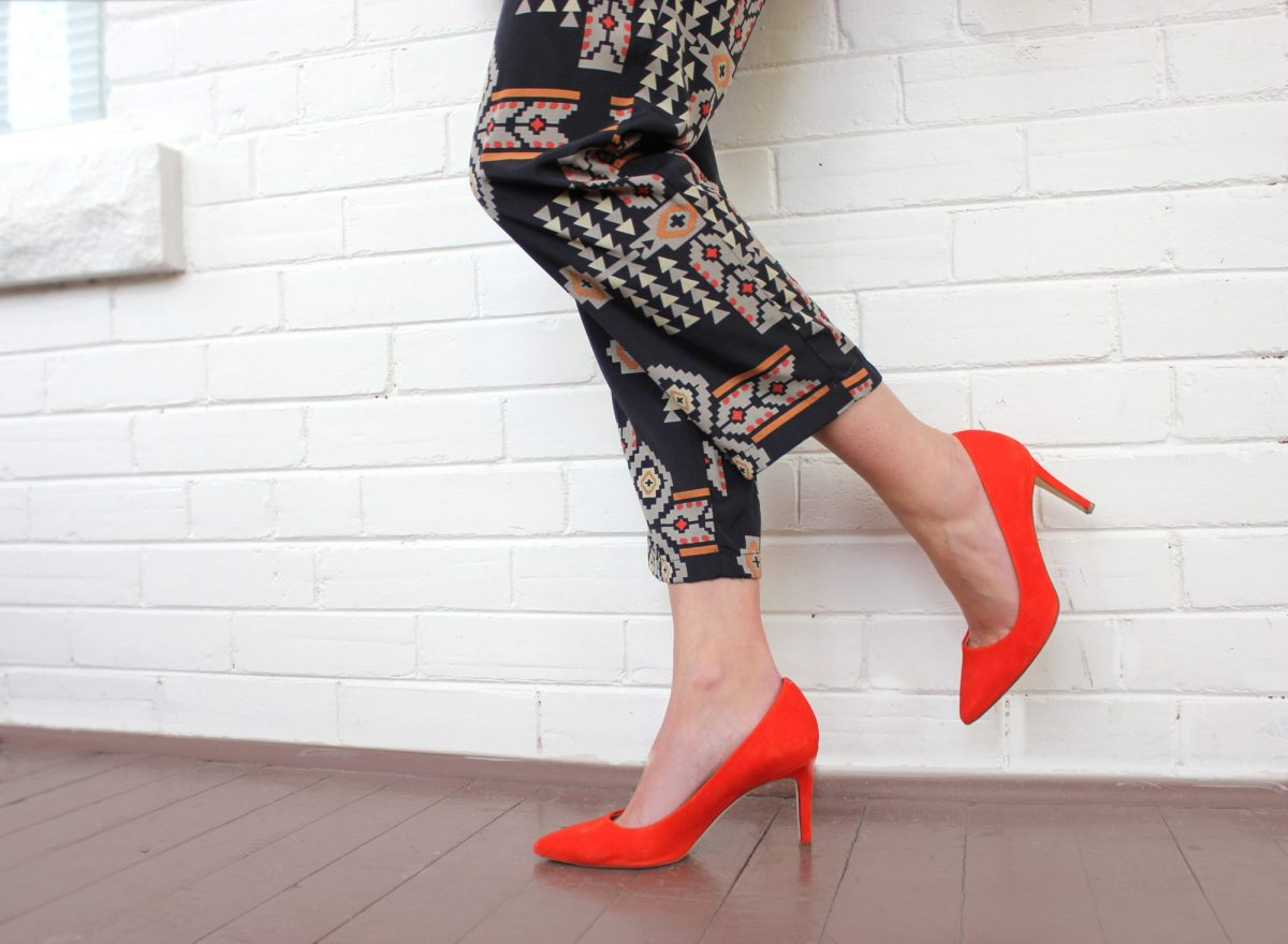 Red Shoes and tribal print pants.
