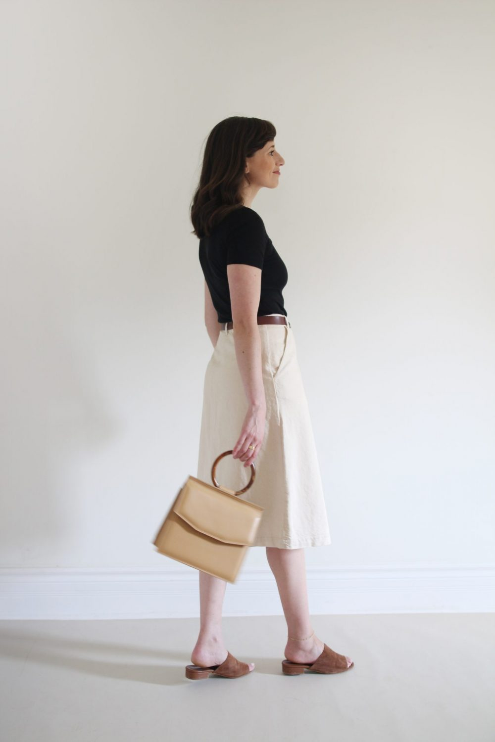 Style Bee - August Outfits - Look 6 - Black Tee + Cream Skirt + Brown Belt _Suede Slides + Structured Bag