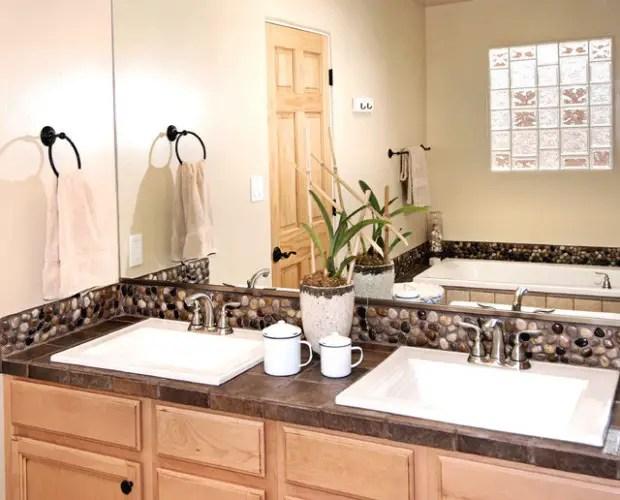 use river rock tile in bathroom design
