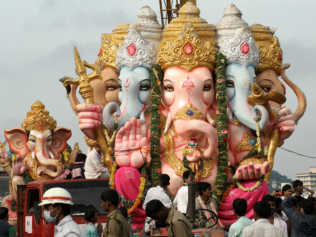 Devotees transport Ganpati Bappa on huge trucks