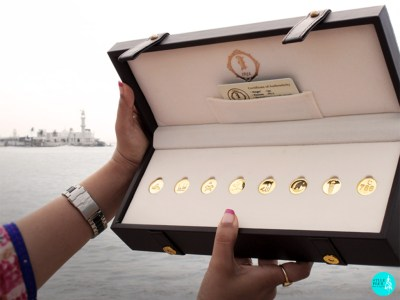 IBJA Gold Coin Gifting Box With 7 Coins With Motifs Of Mecca Madina, Ajmer Sharif, Quran, Bismillah, Allah, Crescent Moon And Star, Eid, Lucky Number 786 And Certificate Of Authenticity.