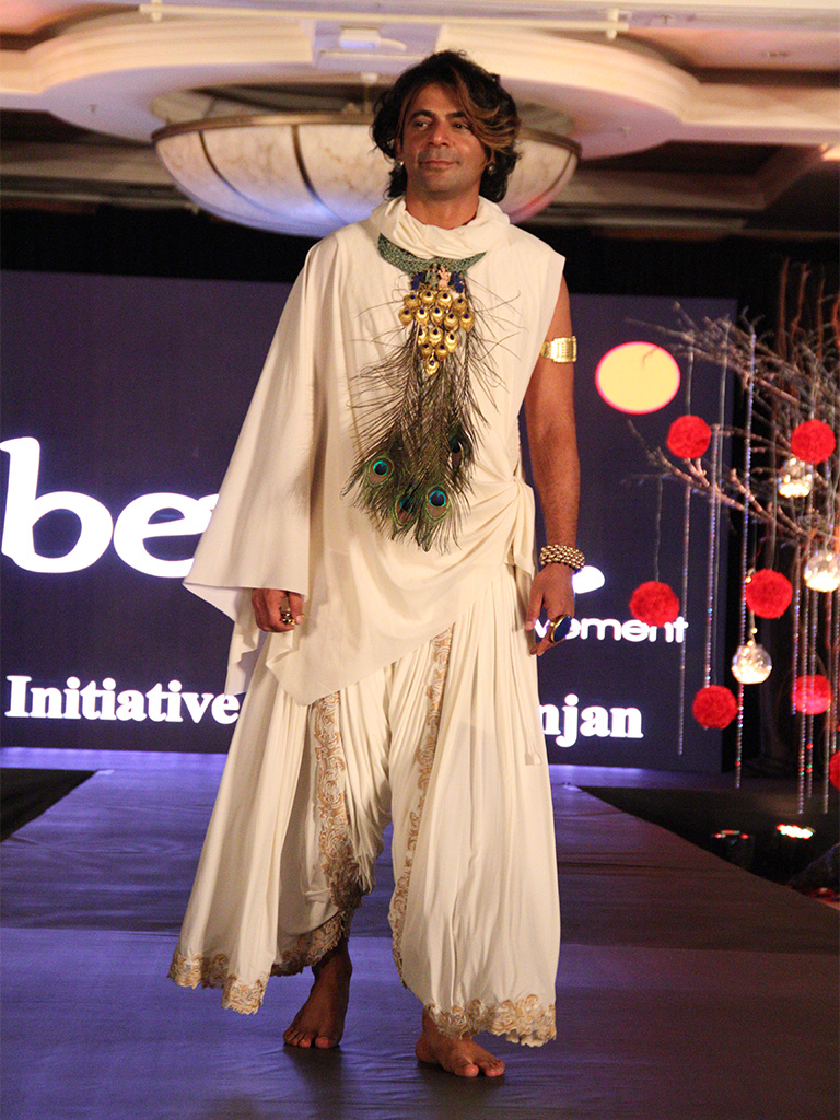 "Sunil Grover wearing ""Madhuban"" handmade Silver Necklace with real Peacock feathers from Adore, dressed as Lord Krishna at the Beti Foundation Jewelry and Fashion Show"