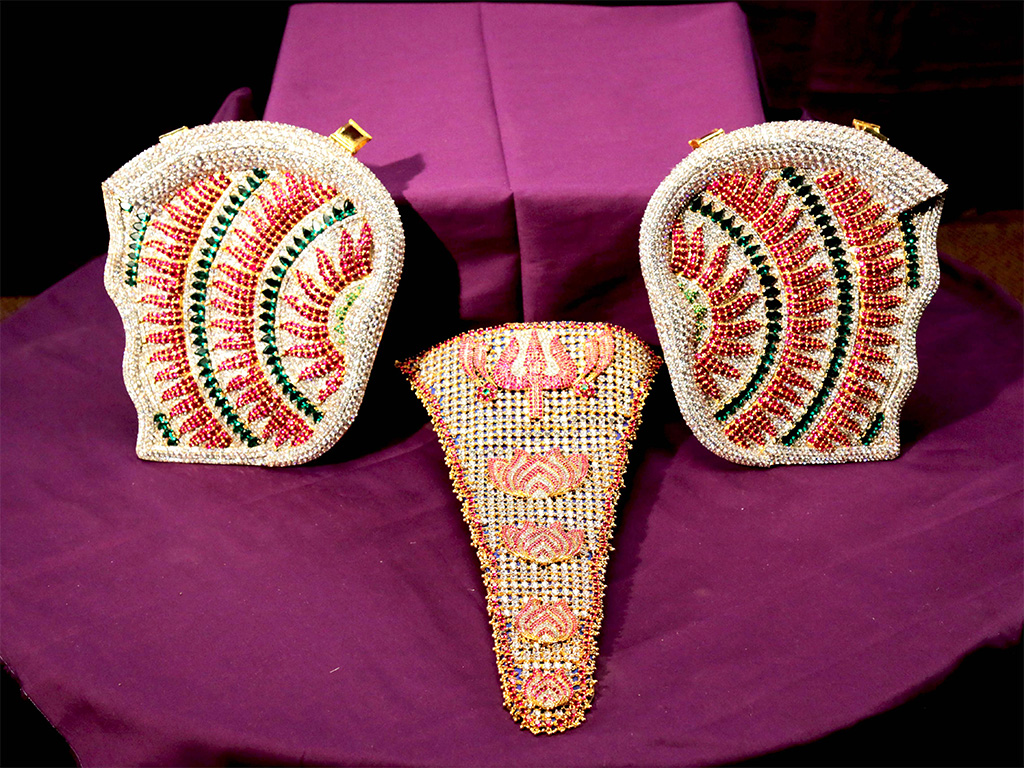 Shrimant Dagdusheth Halwai Ganpati Kaan (Ear), Shund (Trunk) Haar (necklace) studded with stones, gemstones like Emerald and Ruby