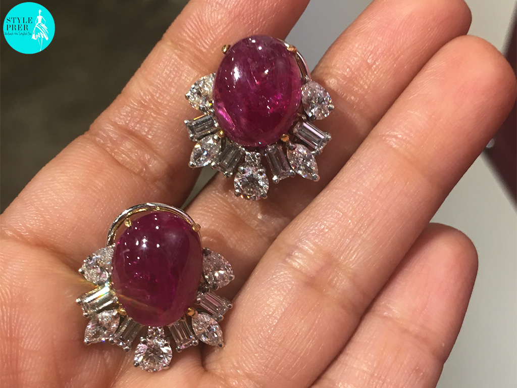 Earrings Set With Cabochon Ruby Surrounded With Round And Fancy Shaped Diamonds. Shot From Iphone