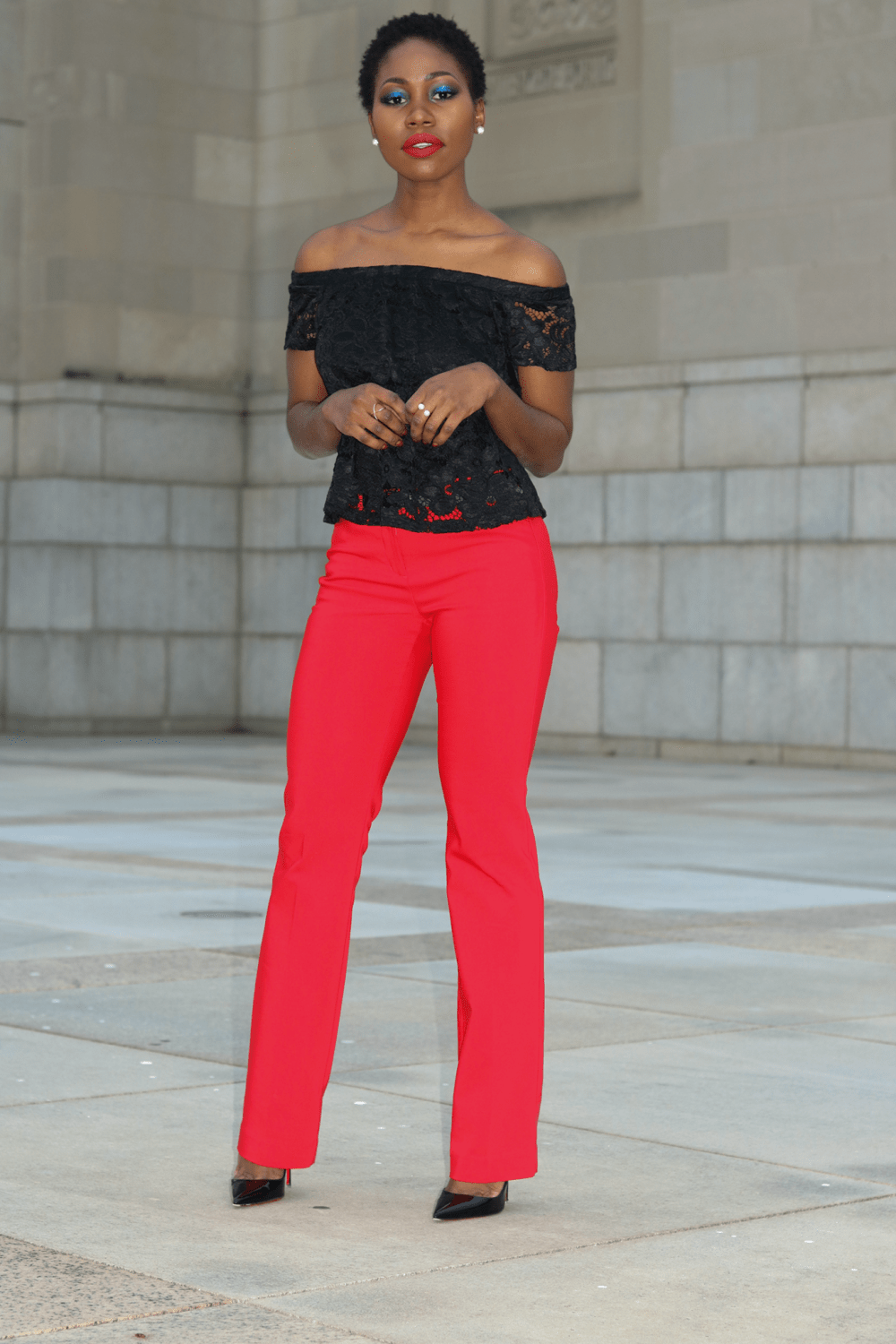 red pants and lace top