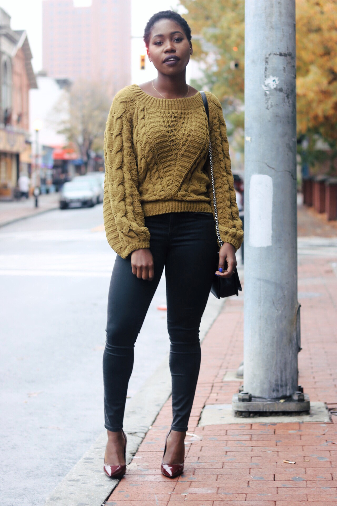 ALT= black leather jeans & yellow chunky sweater