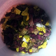 Dried rose petals in container