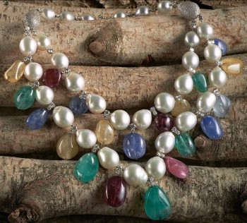 Sidney Garber, 18kt white gold bib necklace with South Sea pearls, multicolored sapphires, rubies, emeralds, and diamonds. $150,000.00