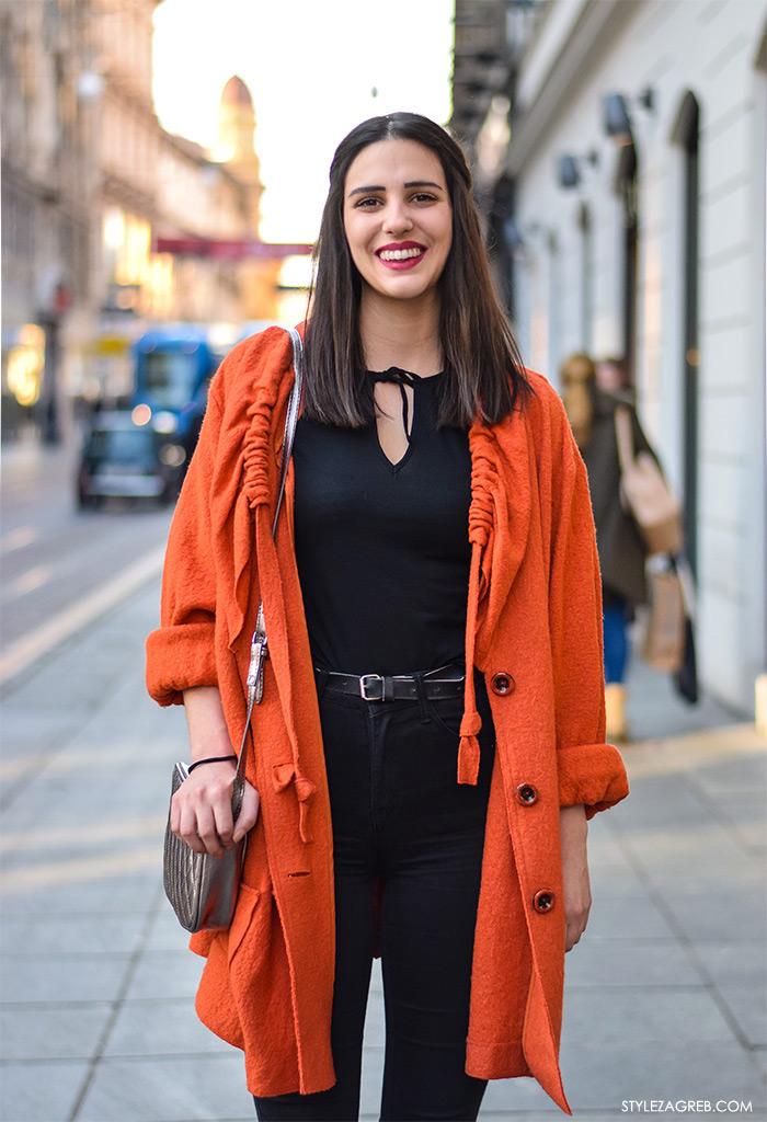 Moda: što se nosi prvih siječanjskih dana u Zagrebu, street style; Tanja Kovač; narančasti second hand kaput, ruž boje vina, uske crne traperice i majica na vezanje, srebrna torbica, čizme preko koljena