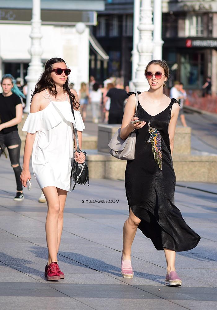 bijela mini haljina otvorenih ramena s volanima, crvene tenisice, crna duga satenska haljina žena sa stilom Zagreb street style ljetna moda srpanj 2017.