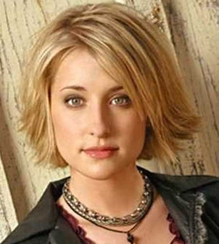 Short and flipped out haircuts for round faces