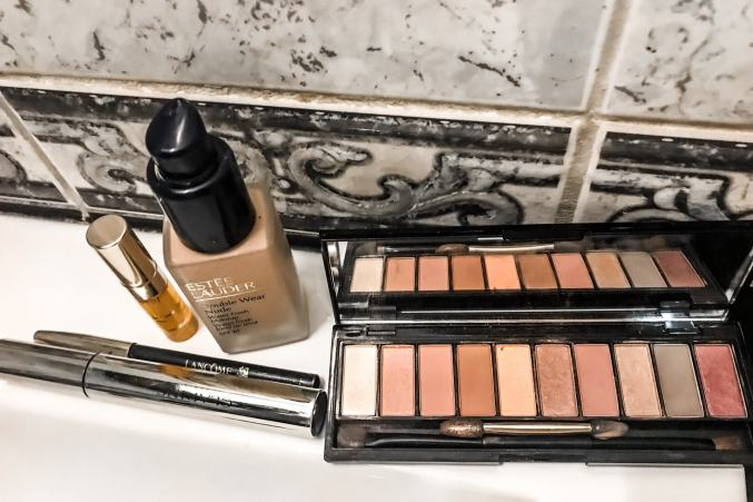make up products displayed on bathroom counter