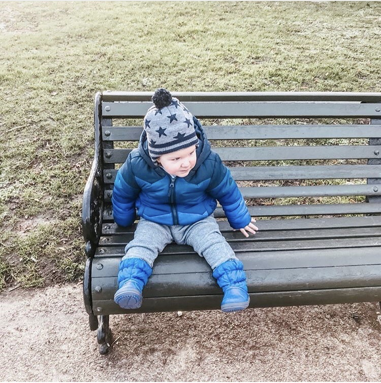kid in park on bench