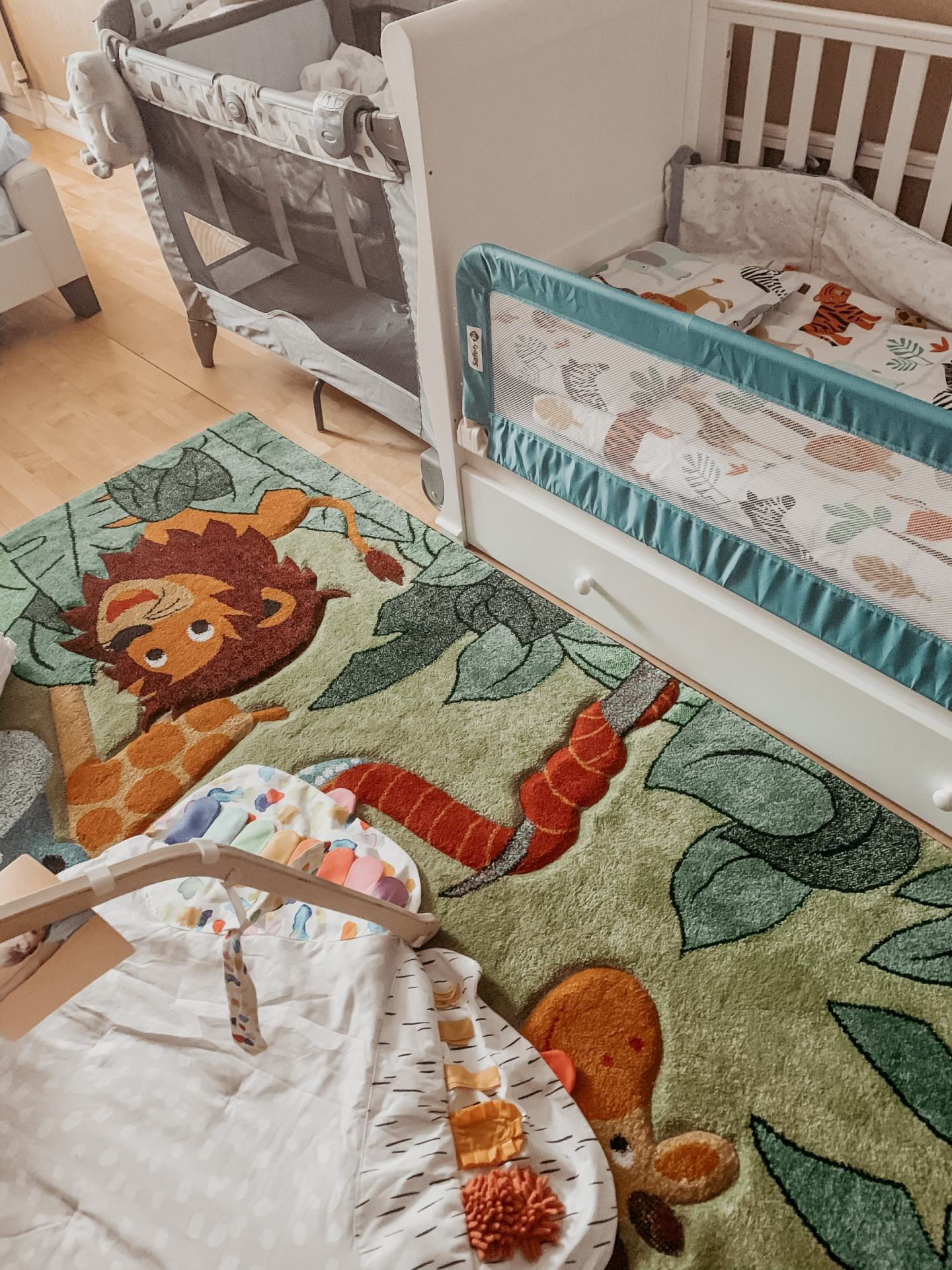 picture of rug, toddler bed, cot bed and play mat
