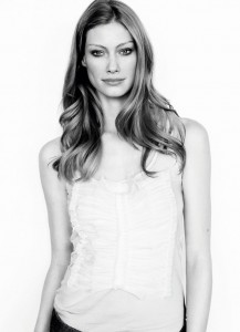 Alyssa Sutherland wearing the classic tank, with silk voile pleat front ($89.95)