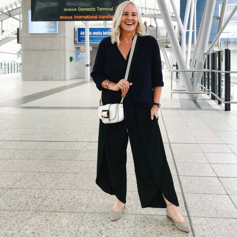 Travel style: Styling You The Label Cate shirt in navy; Maria pants in black | FRANKiE4 Footwear BEC flats in leopard