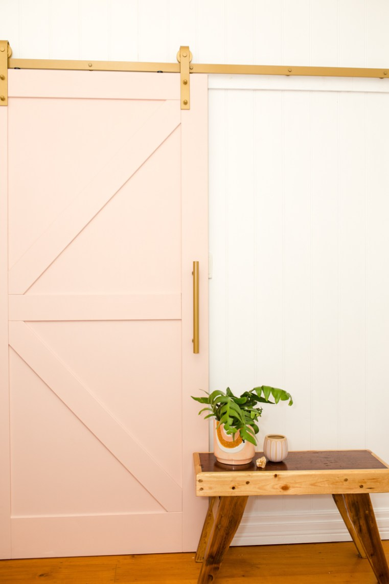 Barn door with brass tracking