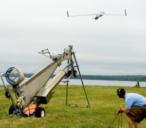 A Naval Surface Warfare Center Dahlgren Division engineer launches the Insitu Scan Eagle unmanned aerial vehicle during a demonstration at the Potomac River Test Range for Coast Guard and Navy leaders on May 3, 2012. The Scan Eagle UAV is scheduled to deploy aboard a Coast Guard National Security Cutter this summer. U.S. Coast Guard Photo by Public Affairs Specialist 1st Class Andy Kendrick