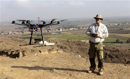 Castillo, a Peruvian archaeologist with Lima's Catholic University and an incoming deputy culture minister, flies a drone over the archaeological site of Cerro Chepen in Trujillo