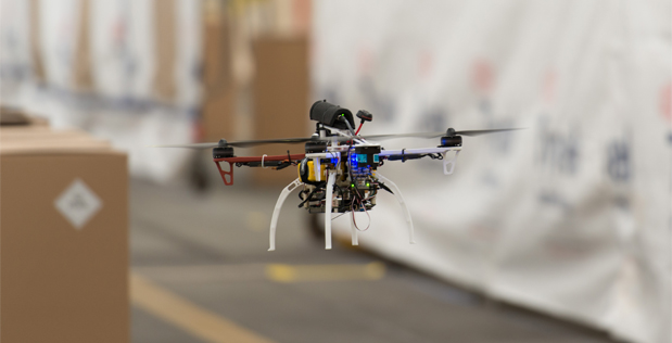 Members of Defense Advanced Research Projects Agency's (DARPA) Fast Lightweight Autonomy (FLA) program used the 102nd Intelligence Wing's hangar to test small UAVs in an indoor, controlled environment.