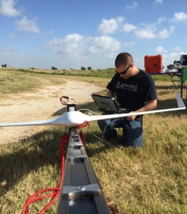 MTSI aerospace engineer Matt Deal prepares the Bramor for launch