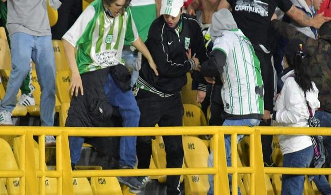 Capturan a hincha de Nacional tras brutal golpiza a hincha de Santa Fe