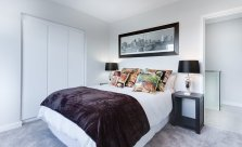 custom framed photo in a bedroom