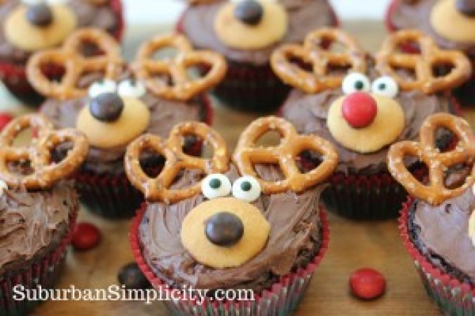 Adorable Reindeer Brownies with red and brown noses sitting on a countertop.