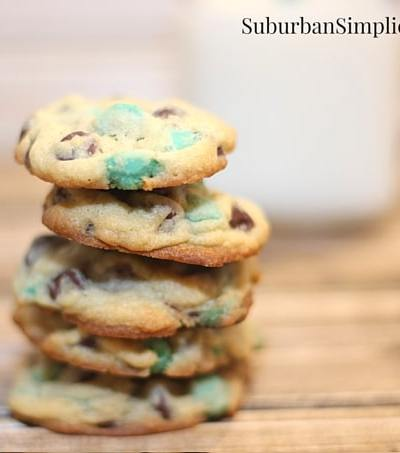 Mint Chocolate Chip Cookie stacks up next to a glass of milk.