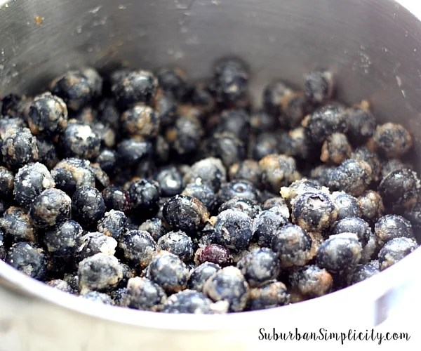Berries for cobbler in a bowl with sugar on top