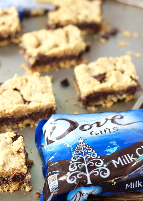 Peanut Butter Chocolate Bars make the perfect dessert! These Pillsbury cake mix bars come together easily with Dove Chocolate and peanut butter to make holiday baking dreamy and delicious!