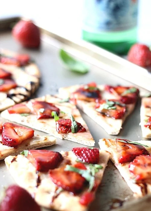 Strawberry Balsamic Flatbread cut into triangles on a baking sheet.