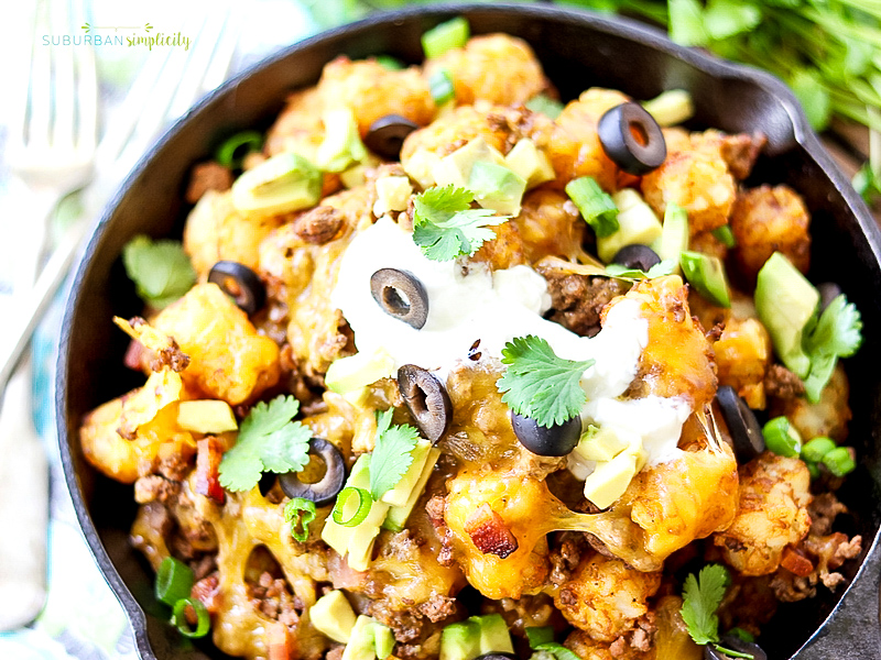 Loaded Tater Tot Nachos with sour cream.