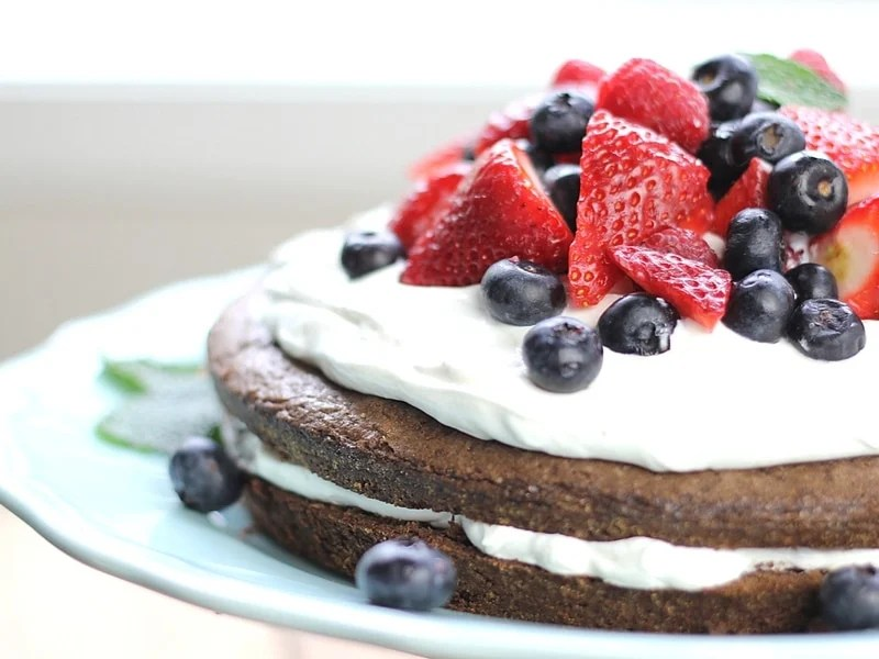 Looking for a yummy brownie recipe? Layers of fudgy chocolate brownie with a creamy center, topped with berries make this Brownie Strawberry Shortcake a winning dessert combination!