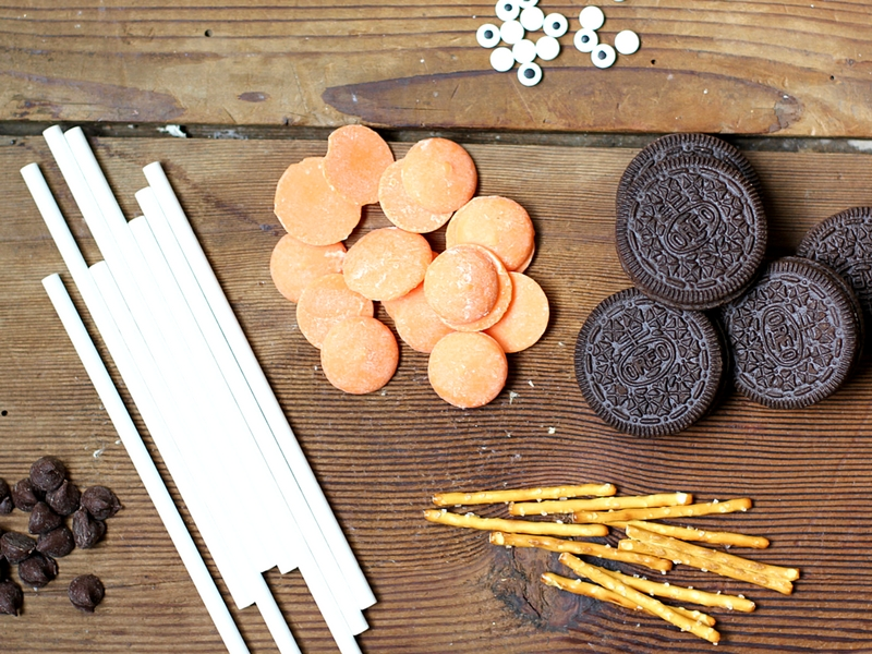Supplies to make Oreo Pumpkin pops.