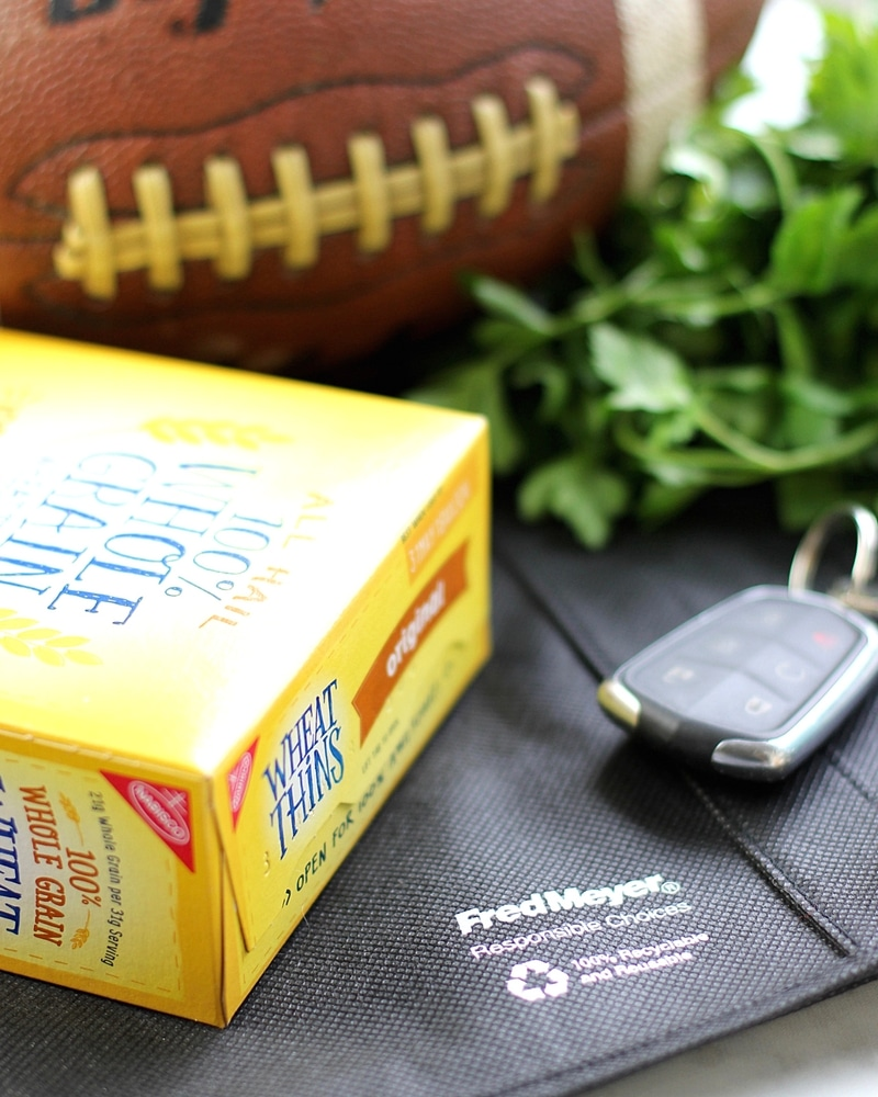 Wheat Thins, a football and keys on a Fred Meyer bag.