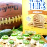Jalapeno topped crackers with a Wheat Thins box and a football in the background.