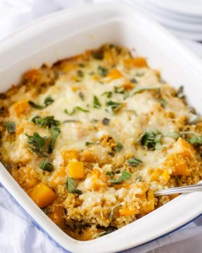 Butternut squash quinoa casserole cooked with melted cheese on top.