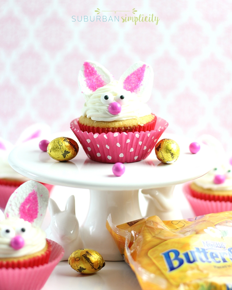 Bunny cupcakes on a cake stand with Butterfinger NestEggs around them.