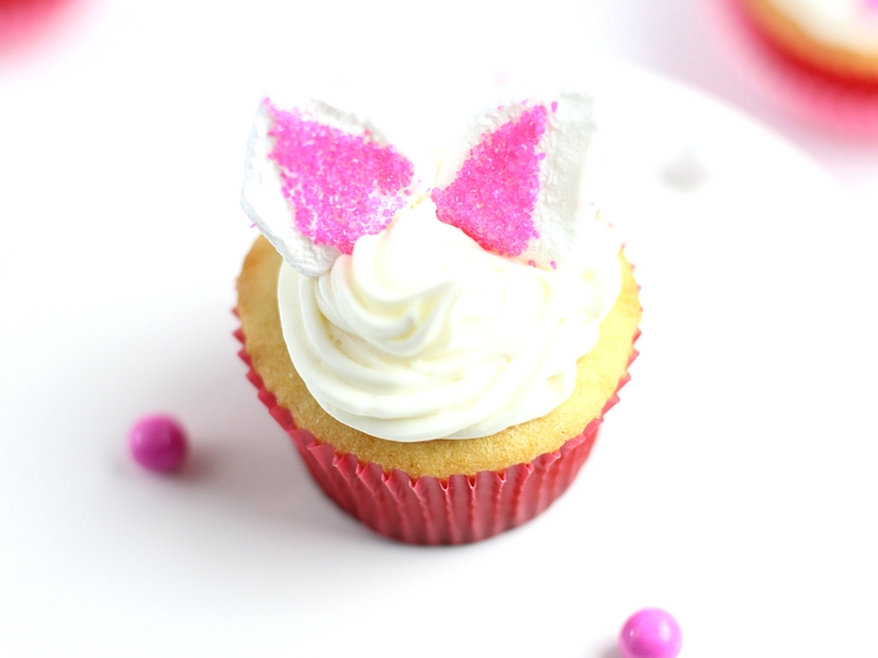 Vanilla Cupcakes with marshmallow ears on top to form Bunny Cupcakes.